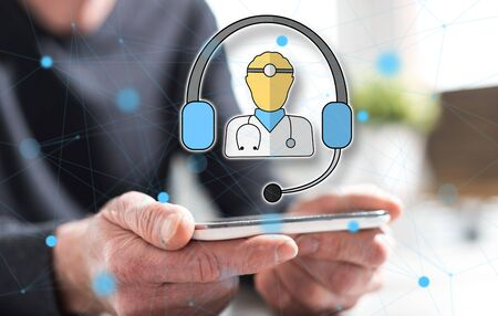 Hands of man holding a smartphone with online medical care concept Stock Photo