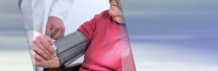 Doctor measuring blood pressure of senior woman. panoramic banner Stock Photo