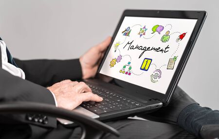 Businessman watching management concept on a laptop Stock Photo