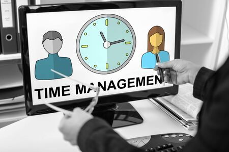 Businesswoman showing time management concept on a computer screen