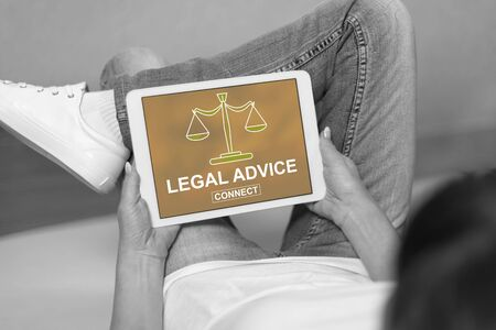 Woman looking at legal advice concept on a tablet Foto de archivo