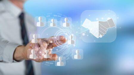 Hombre tocando un concepto de socio comercial en una pantalla táctil con su dedo
