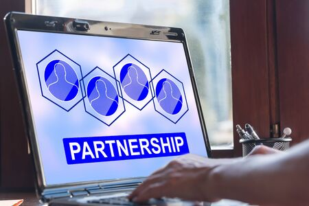 Laptop screen displaying a partnership concept