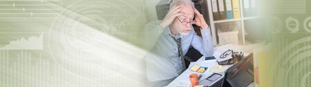 Overworked businessman sitting at a messy desk in office, light effect. panoramic banner