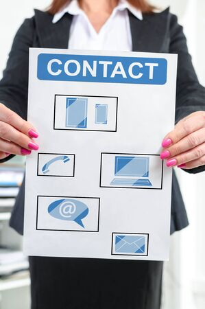 Paper with contact concept held by a businesswoman Stock Photo