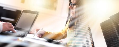 Young businesswoman working on documents at office, light effect; multiple exposure
