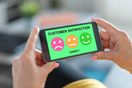 Smartphone screen displaying a customer satisfaction concept Banco de Imagens