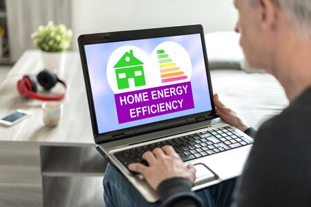 Laptop screen displaying a home energy efficiency concept Stock fotó