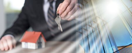 Real estate agent holding house keys, concept of home ownership; multiple exposure