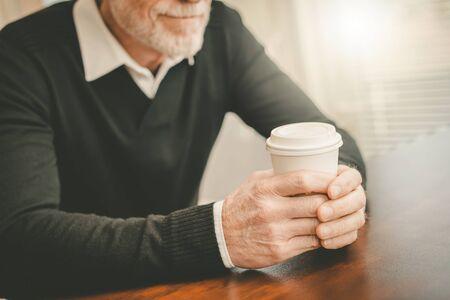 Man having coffee break at home 写真素材