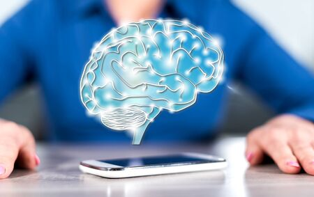 Smartphone with artificial intelligence concept between hands of a woman in background