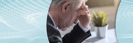 Overworked senior businessman having headache; panoramic banner