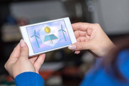 Smartphone screen displaying a clean energy concept Zdjęcie Seryjne