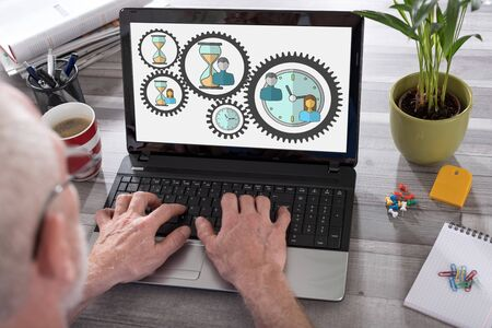 Time management concept shown on a laptop used by a man Standard-Bild - 128773051