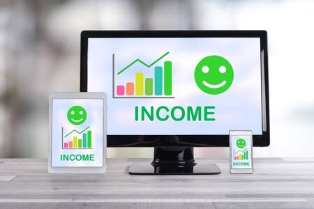Income growth concept shown on different information technology devices Imagens