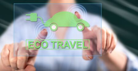 Woman touching an eco travel concept on a touch screen with her fingers Stock Photo