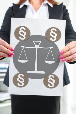 Paper with law concept held by a businesswoman