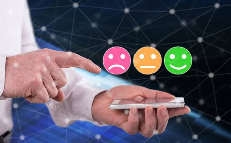 Customer satisfaction concept above a smartphone held by a man