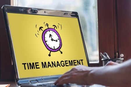 Laptop screen displaying a time management concept Standard-Bild - 128774110