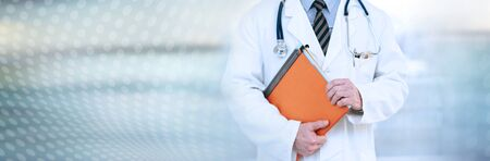 Doctor standing and holding a folder; panoramic banner