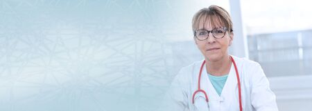 Portrait of female doctor sitting in medical office; panoramic banner