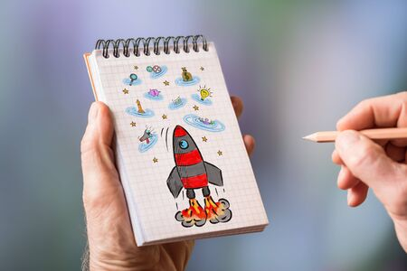 Hand drawing business success concept on a notepad Standard-Bild - 128773607