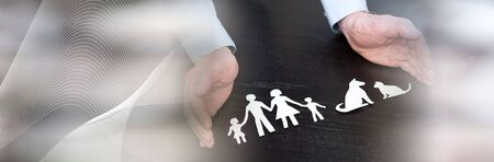 Symbol of family and pet protection by hands of general agent; panoramic banner