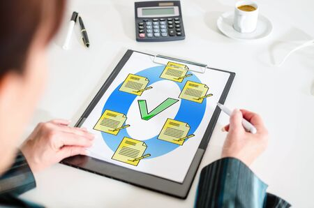 Woman looking at a document validation concept Imagens