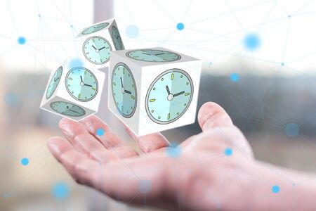 Time management concept above a hand of a man