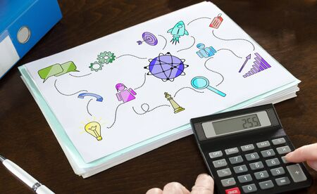 Marketing strategy concept illustrated on a paper with a calculator