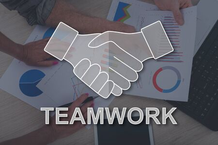 Teamwork concept illustrated by a picture on background Stok Fotoğraf
