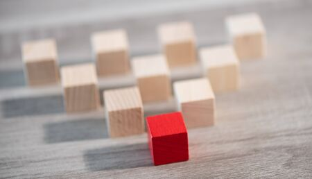 Concept of leadership with wooden cubes