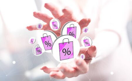 Sale concept between hands of a woman in background