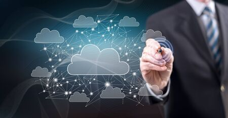 Man touching a cloud networking concept on a touch screen with a stylus pen Stok Fotoğraf