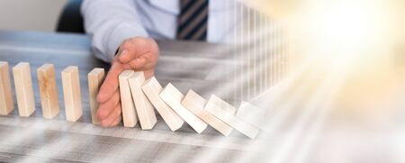 Business control concept by stopping domino effect; multiple exposure 写真素材