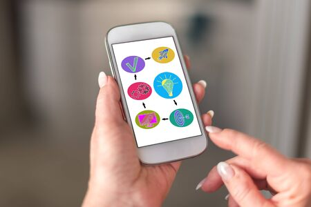 Business strategy concept on a smartphone held by a hand Stok Fotoğraf
