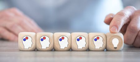 Concept of brainstorming on wooden cubes