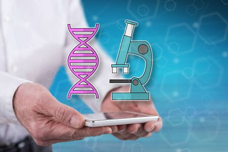 Dna technology concept above a smartphone held by hands