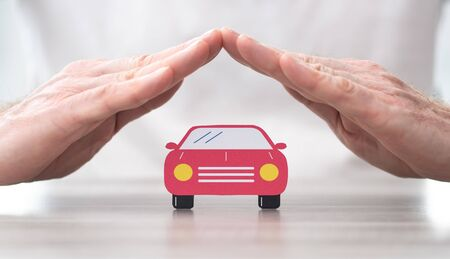 Car protected by hands - Concept of auto insurance Stok Fotoğraf