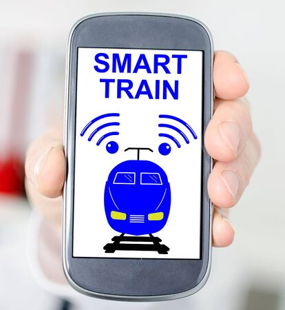 Hand holding a smartphone with smart train concept Stok Fotoğraf