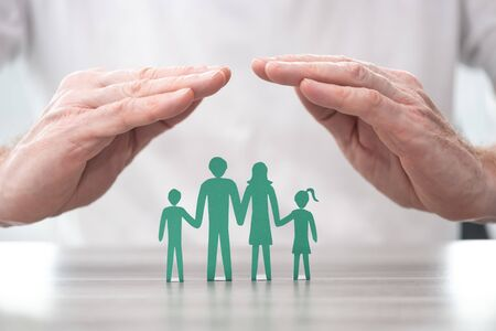 Family protected by hands - Concept of life insurance Stok Fotoğraf
