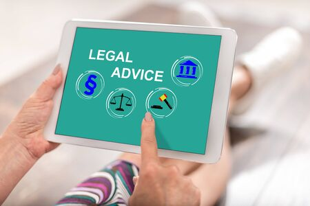 Woman using a tablet with legal advice concept
