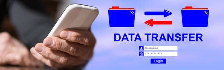 Hand holding mobil phone with data transfer concept on background