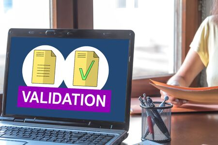 Laptop screen displaying a document validation concept Stok Fotoğraf