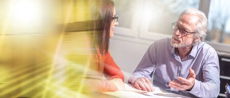 Businesspeople working together in office, light effect; multiple exposure Stok Fotoğraf