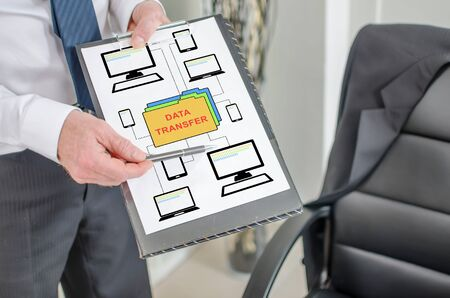 Businessman showing data transfer concept on a clipboard Stock fotó