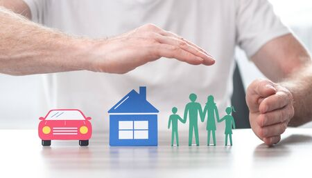 Family, house and car protected by hands - Concept of life, home and auto insurance Stock Photo