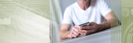 Man sitting using a smartphone; panoramic banner