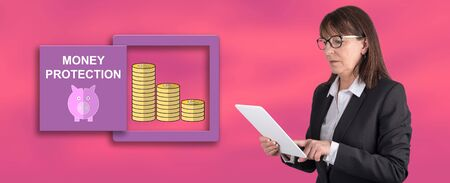 Woman using digital tablet with money protection concept on background Stok Fotoğraf
