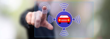 Man touching a smart car concept on a touch screen with his finger Stok Fotoğraf